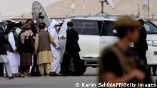 Qatari Deputy Prime Minister and Foreign Minister Mohammed bin Abdulrahman al-Thani (C) boards on a car upon his arrival at the airport in Kabul on September 12, 2021. (Photo by Karim SAHIB / AFP) (Photo by KARIM SAHIB/AFP via Getty Images)