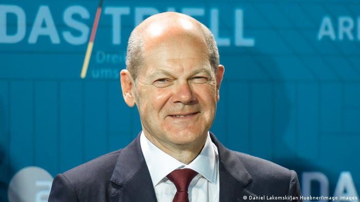 Olaf Scholz smiling