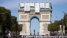 Workers unravel silver blue fabric, part of the process of wrapping the Arc de Triomphe in Paris early September 12, 2021, designed by the late artist Christo. Work has begun on wrapping the Arc de Triomphe in Paris in silvery-blue fabric as a posthumous tribute to the artist Christo, who had dreamt of the project for decades. Bulgarian-born Christo, a longtime Paris resident, had plans for sheathing the imposing war memorial at the top of the Champs-Elysees while renting an apartment near it in the 1960s. Photo by Raphael Lafargue/ABACAPRESS.COM