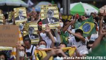 People attend a protest to demand the impeachment of Brazil's President Jair Bolsonaro and against his handling of the coronavirus disease (COVID-19) pandemic, at Paulista Avenue in Sao Paulo, Brazil, September 12, 2021. REUTERS/Amanda Perobelli