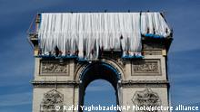 The Arc de Triomphe monument being wrapped in material