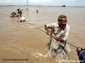 Flood victims hang on a rope as they flee the flooded areas in Shikarpur, Sindh province Pakistan on 16 August 2010. More than 1500 people across Pakistan have been killed and hundreds of thousands stranded due to flash floods triggered by the ongoing spell of monsoon rains. The worst floods the country has faced in several decades washed away millions of hectares of crops, submerged villages and destroyed roads and bridges in the north-western province of KhyberPakhtunkhwa, parts of the Pakistan-administered Kashmir region and the eastern province of Punjab. EPA/NADEEM KHAWER