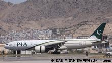 13.09.2021 *** A Pakistan International Airlines plane carrying a handful of passengers, which is the first international commercial flight to land since the Taliban retook power in Afghanistan on August 15, is seen after landing at the airport in Kabul, on September 13, 2021. (Photo by Karim SAHIB / AFP) (Photo by KARIM SAHIB/AFP via Getty Images)