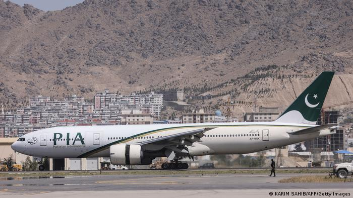 A Pakistan International Airlines plane carrying a handful of passengers at Kabul airport