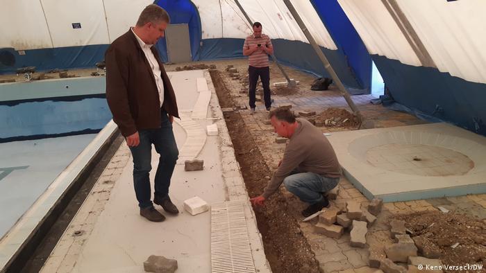 Zoltan Soos looking at building work