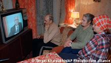 FILE - In this Wednesday, Dec. 25, 1991 file photo, family members watch Soviet President Mikhail Gorbachev's resignation speech on Soviet television in their downtown Moscow apartment, Russia. AP's Nataliya Vasilyeva, who was seven when the Soviet Union collapsed on Dec. 25, 1991, describes what life was like for her generation, the first to grow up in post-Soviet Russia. (AP Photo/Sergei Kharpukhin, file)
