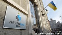 The logo of national oil and gas company Naftogaz Ukraine is seen at the company office entrance, in Kyiv, Ukraine, on 18 December, 2019. (Photo by STR/NurPhoto)