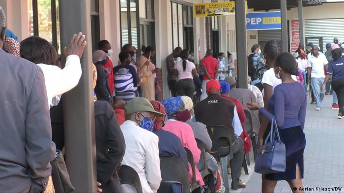 People queue outside a supermarket in South Africa