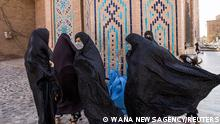 Afghan women walk at a mosque in Herat, Afghanistan September 10, 2021. WANA (West Asia News Agency) via REUTERS ATTENTION EDITORS - THIS IMAGE HAS BEEN SUPPLIED BY A THIRD PARTY.