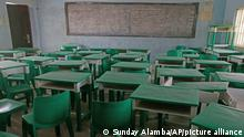 FILE - In this Monday, March 1, 2021 file photo, empty desks and chairs are seen at the Government Girls Secondary School where more than 300 girls were abducted by gunmen on Friday, in Jangebe town, Zamfara state, northern Nigeria. Schools in northern Nigeria are on high alert after the kidnappings at the Salihu Tanko Islamic School in Niger state on Sunday, May 30, 2021 marked the latest in a long spate of violent abductions carried out for ransom this year by unknown attackers in the north. (AP Photo/Sunday Alamba, File)