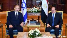 A handout picture released by the Egyptian Presidency on September 13, 2021, shows Egyptian President Abdel Fattah al-Sisi (R) meeting with Israeli Prime Minister Naftali Bennett in the Egyptian Red Sea resort town of Sharm El-Sheikh. - Bennett met Sisi on the first visit to Egypt by an Israeli prime minister in over a decade. They were to discuss efforts to revive the peace process between the Israelis and Palestinians, presidential spokesman Bassam Radi said in a statement. (Photo by - / EGYPTIAN PRESIDENCY / AFP) / === RESTRICTED TO EDITORIAL USE - MANDATORY CREDIT AFP PHOTO / HO / EGYPTIAN PRESIDENCY' - NO MARKETING NO ADVERTISING CAMPAIGNS - DISTRIBUTED AS A SERVICE TO CLIENTS ==