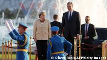 German Chancellor Angela Merkel (2nd L) and Serbian President Aleksandar Vucic inspect a military guard of honour prior to their meeting in Belgrade, Serbia, on September, 13, 2021. - Angela Merkel is on a three-day visit to the Balkan States of Serbia and Albania. (Photo by OLIVER BUNIC / AFP) (Photo by OLIVER BUNIC/AFP via Getty Images)