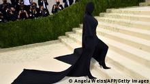 US socialite Kim Kardashian arrives for the 2021 Met Gala at the Metropolitan Museum of Art on September 13, 2021 in New York. - This year's Met Gala has a distinctively youthful imprint, hosted by singer Billie Eilish, actor Timothee Chalamet, poet Amanda Gorman and tennis star Naomi Osaka, none of them older than 25. The 2021 theme is In America: A Lexicon of Fashion. (Photo by Angela WEISS / AFP) (Photo by ANGELA WEISS/AFP via Getty Images)
