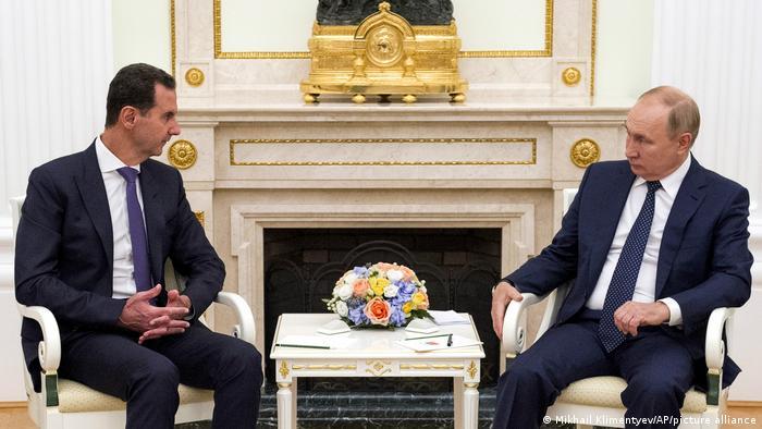 Bashar al Assad (kiri) dan Vladimir Putin (kanan)