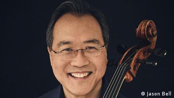 A portrait of Yo-Yo Ma with his cello.