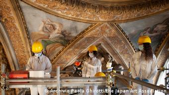 Art restorers working on a fresco in Italy.
