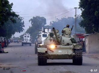 African union peacekeepers in Somalia patrol in a tank as they assists government forces during clashes with Islamist insurgents in southern Mogadishu, Somalia, on Monday Aug. 16, 2010. (AP Photo/Farah Abdi Warsameh)