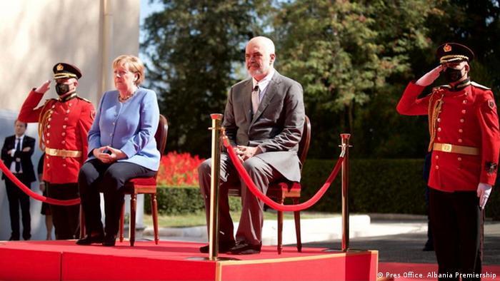 Angela Merkel at a ceremony in Tirana