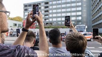 A group of people recording something with their smartphones