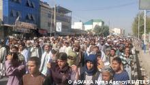 People hold a protest march against the Taliban's decision to force them to leave their homes in Kandahar, Afghanistan September 14, 2021, in this still image taken from video. ASVAKA News Agency/Handout via REUTERS THIS IMAGE HAS BEEN SUPPLIED BY A THIRD PARTY. MANDATORY CREDIT