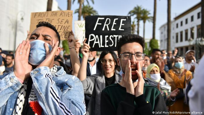 People shout slogans as they gather to stage a protest in solidarity with Palestinians, in Rabat, Morocco