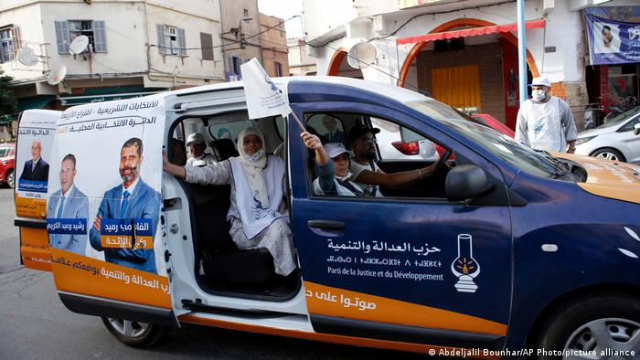 Supporters wave the pjd flag during a drive-by campaign in Casablanca, Morocco, on Monday, Sept. 6, 2021
