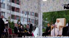 Pope Francis meets members of the Roma community at Lunik IX, in Kosice, Slovakia, Tuesday, Sept. 14, 2021, the biggest of about 600 shabby, segregated settlements where the poorest 20% of Slovakia's 400,000 Roma live. Pope Francis traveled to Kosice, in the far east of Slovakia on Tuesday to meet with the country's Roma in a gesture of inclusion for the most socially excluded minority group in Slovakia, who have long suffered discrimination, marginalization and poverty. (AP Photo/Gregorio Borgia)