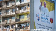 People welcome the Pope Francis, who will meet local Roma minority at biggest Slovak Roma housing estate Lunik IX in Kosice today, on Tuesday, September 14, 2021, during his four-day visit to Slovakia, which started on Sunday. (CTK Photo/Roman Vondrous)