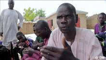itel: Vigilantes battle Boko Haram Ort: Doublé, Cameroon Schlagwörter: Cameroon, vigilantes, Boko Haram, terrorism Datum: 14.09.2021 Rechte: DW Bild: Cameroon vigilantes.jpg Bildbeschreibung: Vigilante group member Alhaji Sharifu speaks to DW reporter Blaise Eyong.