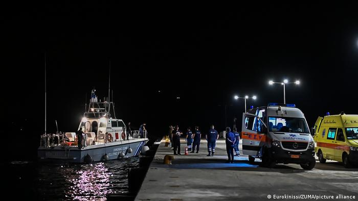 A coast guard vessel arrives with two bodies at Pythagorio port, on the eastern Aegean island of Samos, Greece