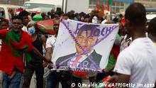 Supporters of Angolan opposition party UNITA - National Union for the Total Independence of Angola, carry the image of Joo Louren?o, President of Angola, in Luanda during a demonstration against the reform of the electoral law. (Photo by Osvaldo Silva / AFP) (Photo by OSVALDO SILVA/AFP via Getty Images)