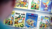 epa02865325 A fan looks at comic books at the Roman Museum in Haltern am See, Germany, 13 August 2011. Asterix books from different countries are on display during the 9th International Asterix Fans meeting. EPA/ROLF VENNENBERND