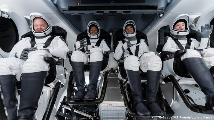 From left, Chris Sembroski, Sian Proctor, Jared Isaacman and Hayley Arceneaux sit in the Dragon capsule