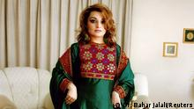 A woman poses in traditional Afghan attire, in Kabul, Afghanistan, 2005, in this picture obtained from social media. Dr. Bahar Jalali/via REUTERS THIS IMAGE HAS BEEN SUPPLIED BY A THIRD PARTY. MANDATORY CREDIT. NO RESALES. NO ARCHIVES.