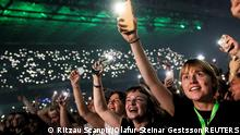 People attend a concert by a Danish band The Minds of 99 amid the coronavirus disease (COVID-19) outbreak, in Copenhagen's Parken stadium, Denmark, September 11, 2021. Picture taken September 11, 2021. Ritzau Scanpix/Olafur Steinar Gestsson via REUTERS THIS IMAGE HAS BEEN SUPPLIED BY A THIRD PARTY. DENMARK OUT. NO COMMERCIAL OR EDITORIAL SALES IN DENMARK