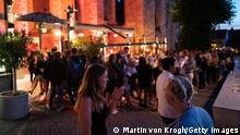 GOTLAND, SWEDEN - JULY 17: People stand in line without social distancing outside a restaurant on July 17, 2020 in Gotland, Sweden. Sweden largely avoided imposing strict lockdown rules on its citizens as the coronavirus (COVID-19) arrived earlier this year. Consequently, it has recorded thousands more deaths than other Scandinavian countries, putting its per capita death rate higher than that of the United States. (Photo by Martin von Krogh/Getty Images)