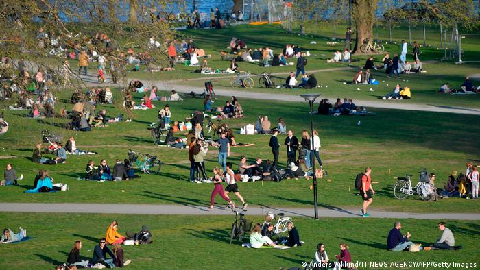 People hanging out in a park in Stockholm