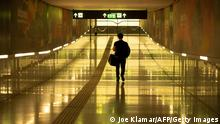 TOPSHOT - A man walks through a tunnel at the train station towards the Austrian Airlines terminal at Vienna's International Airport in Austria on May 19, 2020. - Austrian Airlines is negotiating with Austria's government for its support to save the carrier struggling amid the new coronavirus crisis. (Photo by JOE KLAMAR / AFP) (Photo by JOE KLAMAR/AFP via Getty Images)