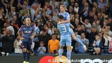 Soccer Football - Champions League - Group A - Manchester City v RB Leipzig - Etihad Stadium, Manchester, Britain - September 15, 2021 Manchester City's Ruben Dias and Kevin De Bruyne celebrates their second goal, an own goal scored by RB Leipzig's Nordi Mukiele Action Images via Reuters/Lee Smith