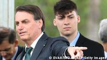 Brazilian President Jair Bolsonaro (R) gestures next to his son Jair Renan Bolsonaro, during the launch of his new party, the Alliance for Brazil, at a hotel in Brasilia on November 21, 2019. - Bolsonaro left the Social Liberal Party after a disagreement with the party president Luciano Bivar. (Photo by EVARISTO SA / AFP) (Photo by EVARISTO SA/AFP via Getty Images)