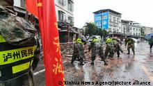 (210916) -- LUXIAN, Sept. 16, 2021 (Xinhua) -- Photo taken with a mobile phone shows rescuers removing debris on a street in Fuji Town of Luxian County, southwest China's Sichuan Province, Sept. 16, 2021. Two people were dead and three others injured after a 6.0-magnitude earthquake jolted Luxian County at 4:33 a.m. Thursday (2033 GMT Wednesday). The quake also damaged houses. (Xinhua)