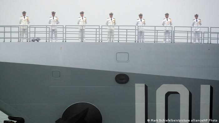 Sailors on a new Chinese guided missile destroyer