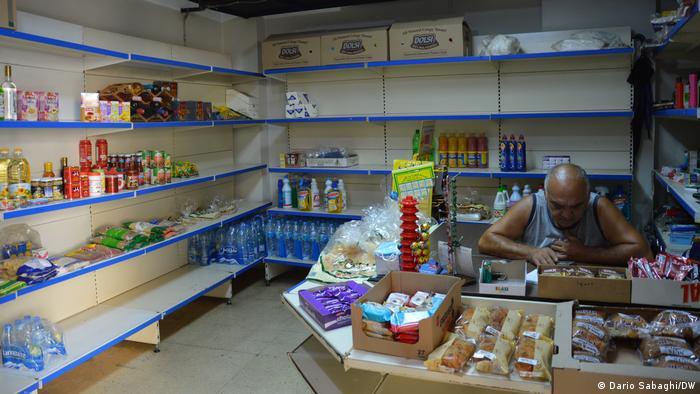 Half-empty shelves in a Beirut shop