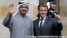French President Emmanuel Macron (R) poses with Abu Dhabi Crown Prince Mohammed bin Zayed (L) upon their arrival at the Fontainebleau's castle in Fontainebleau, on September 15, 2021, ahead of their working lunch. (Photo by STEFANO RELLANDINI / AFP) (Photo by STEFANO RELLANDINI/AFP via Getty Images)
