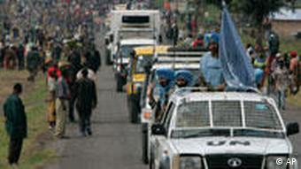 Indian United Nations soldiers escort a humanitarian convoy past a displaced people's camp in the DRC