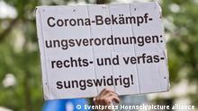 Schild mit Aufschrift Corona-Bekaempfungsverordnungen rechts- und verfassungswidrig bei einer Querdenken Demonstration in Berlin. Die Demonstration richtet sich gegen die restriktiven Massnahmen der Bundesregierung im Zusammenhang mit der von der WHO ausgerufenen Corona-Pandemie und massive Einschraenkungen von Grundrechten.