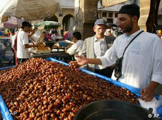 A street vendor sells dates and dried fruits in Casablanca