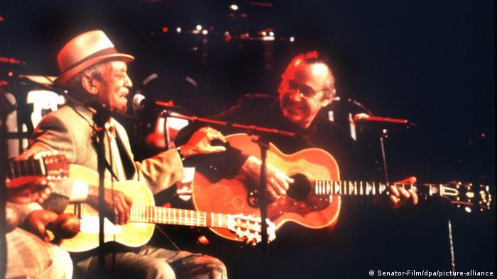 Film still , Compay Segundo and Ry Cooder, two guitarists on stage