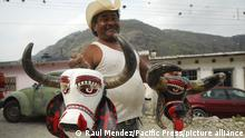 A man wearing a costume with a mask in part of the Afro-Carnival celebration in Coyolilo; 300 kilometers away from the Mexico City. The annual celebration of carnival has a roots of African slaves who settled in this region. (Photo by Raul Mendez / Pacific Press)