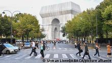Wrapped Arc de Triomphe before an inauguration in Paris, France, on Sept. 16, 2021. The entire Arc de Triomphe at the top of the Champs-Elysees in Paris is to stay wrapped in fabric for two weeks, an art installation conceived by the late artist Christo and inaugurated on Thursday by French President Emmanuel Macron. The 50-meter high, 45-meter long and 22-meter wide monument built by Napoleon, is now wrapped head to toe in 25,000 square metres of recyclable silvery-blue fabric and 3,000 meters of red rope. Photo by Lionel Urman/ABACAPRESS.COM